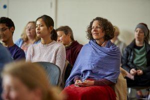 People sitting listening to Dharma Talk