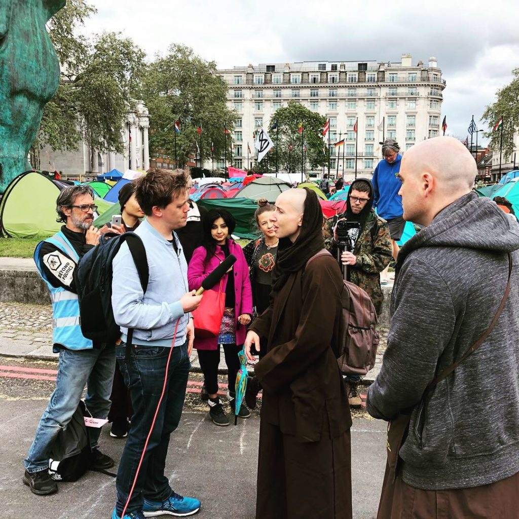 Monastics being interviewed